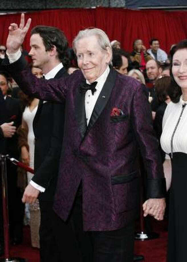 Peter O'Toole, best-actor nominee for Venus, walks the carpet in royal purple. Photo: KEVORK DJANSEZIAN, ASSOCIATED PRESS