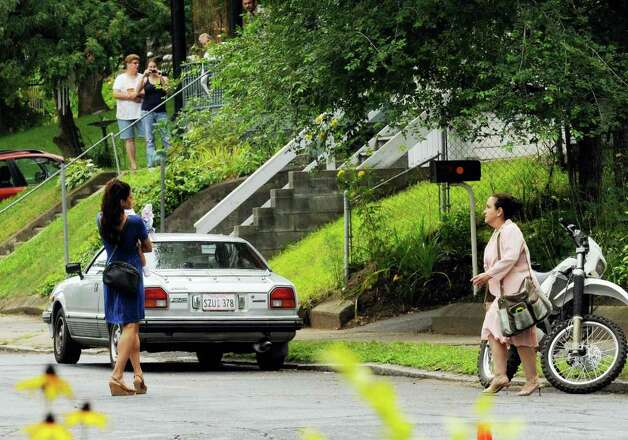 "Actress Eva Mendes, left, on the set of  ""The Place Beyond The Pines"" on Watt Street in Schenectady, NY, on Tuesday, Aug. 9, 2011.( Michael P. Farrell/Times Union archive) Photo: Michael P. Farrell"