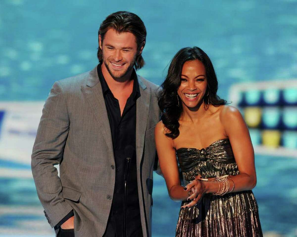 UNIVERSAL CITY, CA - AUGUST 07: Actors Chris Hemsworth (L) and Zoe Saldana speak onstage during the 2011 Teen Choice Awards held at the Gibson Amphitheatre on August 7, 2011 in Universal City, California.