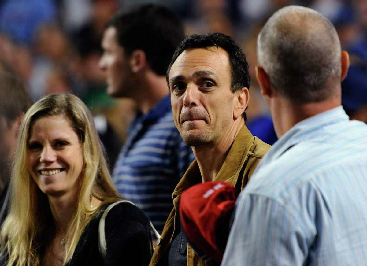 Actor Hank Azaria attends the baseball game between the Philadelphia Phillies and the Los Angeles Dodgers at Dodger Stadium in Los Angeles, California.