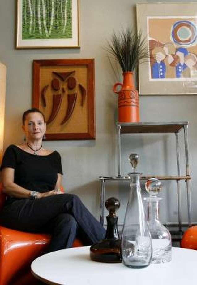 Karen Moyers-Stodelle, owner of the Mod Pod, a narrow shop on Milam. Sharon Steinmann / Chronicle Photo: Sharon Steinmann, Chronicle