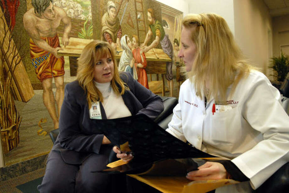 Jessica Varisco, left, visits with Dr. Rosemary Buckle about a future patient in the lobby of the St. Joseph Medical Center. Photo: Kim Christensen, For The Chronicle