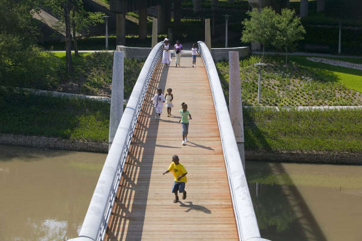 A pedestrian bridge joining the north and south sides of Buffalo Bayou is one of many improvements that has made the area more accessible.