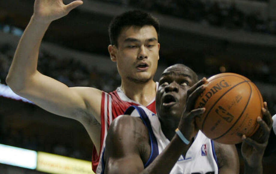 Yao Ming was able to contain Mavs center DeSagana Diop, but Dallas found other ways to hurt the Rockets. Photo: Donna McWilliam, AP