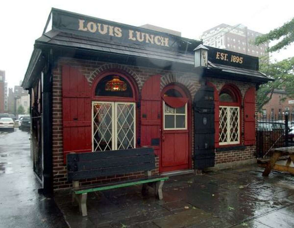 """Next: Louis' Lunch, New Haven You might be a little hungry already. No worries, now's the perfect chance to stop for a quick bite. How about Louis' Lunch, in New Haven, where America's much beloved """"hamburger"""" was created."""