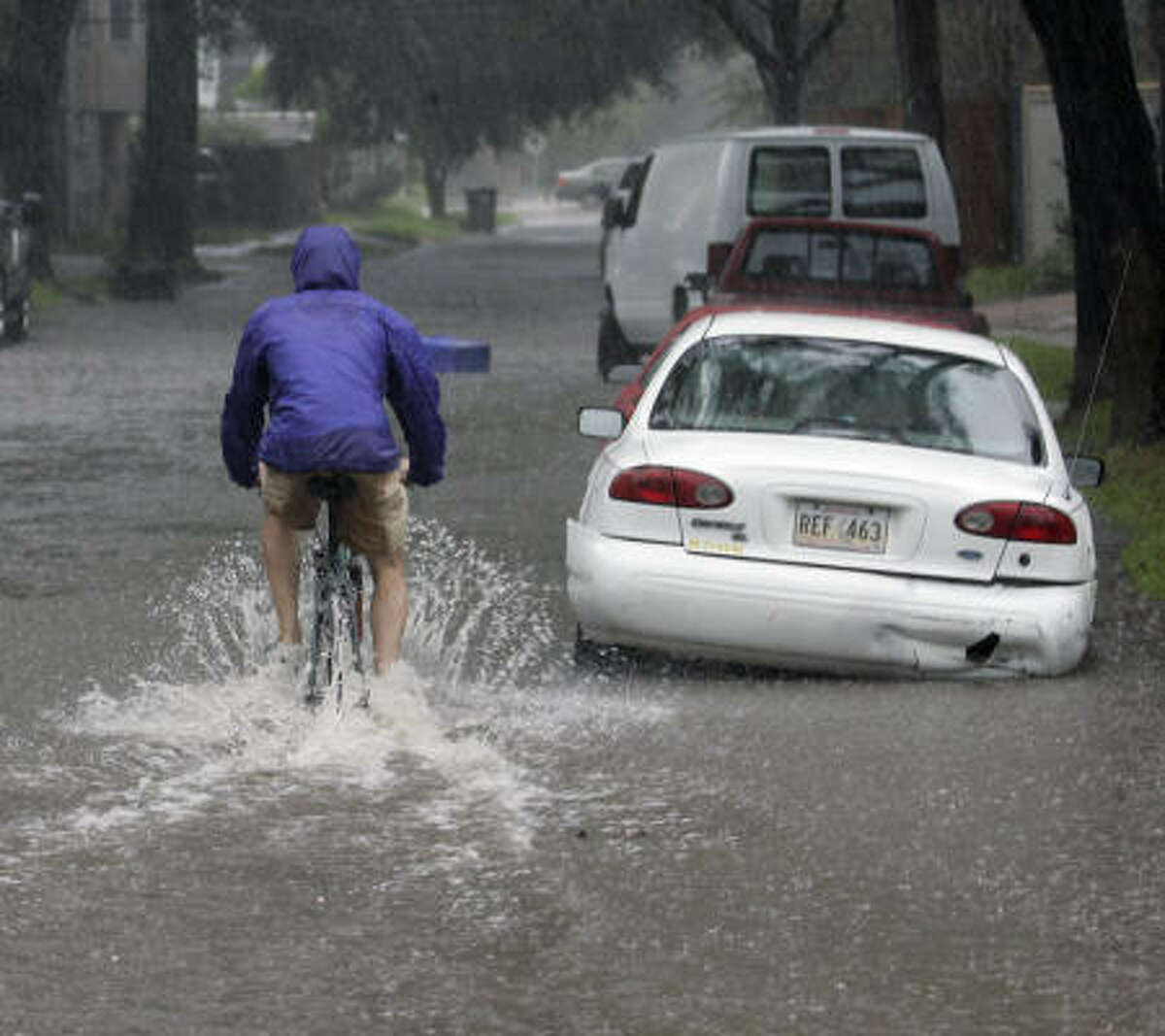 A man rides his bike through a flooded street in the Uptown section of New Orleans on Thursday. Humberto dumped heavy rain on much of Louisiana, flooding streets as it lumbered across the state.