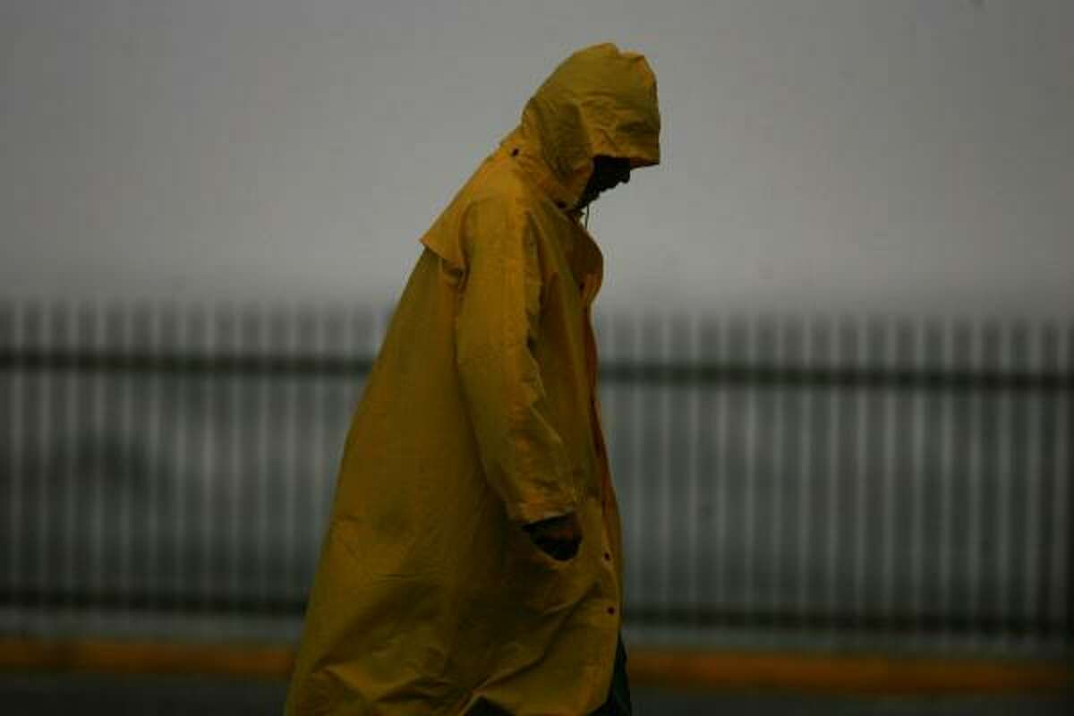 A man walks on the pier of the Flagship Hotel in Galveston on Wednesday.