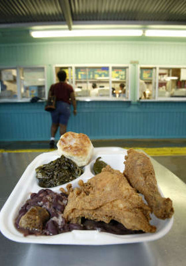 A Frenchy's meal of fried chicken, greens, red beans and rice and a biscuit. Photo: CRAIG H. HARTLEY, For THE CHRONICLE