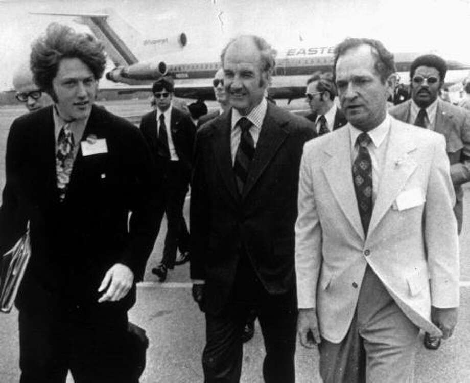 Then-Sen. George McGovern, center, arrives in Little Rock, Ark., in this file photo from early 1972, during his campaign for the Democratic presidential nomination. Bill Clinton, left, then a McGovern campaign worker, and Joe Purcell, chairman of the state Democratic Party, meet McGovern at the airport. Photo: ASSOCIATED PRESS