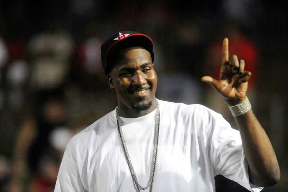 Boston Celtic basketball player Kendrick Perkins flashes the Lamar hand sign to fans during the fourth quarter of the Lamar Cardinals matchup against Webber International at Provost Umphrey Stadium.  Saturday, September 11, 2010  Valentino Mauricio/The Enterprise Photo: Valentino Mauricio / Beaumont