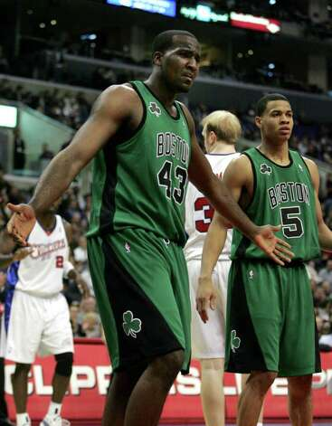 Boston Celtics'  Kendrick Perkins argues a call during the second half of an NBA basketball game against the Los Angeles Clippers on Wednesday, Dec. 27, 2006, in Los Angeles. Celtics' Gerald Green (5) looks on at left. (AP Photo/Jeff Lewis) Photo: Jeff Lewis, STR / Beaumont
