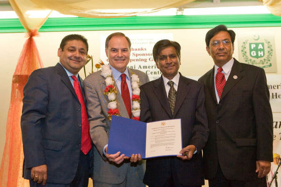 U.S. Rep. Nick Lampson, D-District 22, second from left, presents a congressional certificate during the opening gala of the Pakistani-American Community Center on Bissonnet. Accepting are PAGH president Ghulam Bombaywala, left, secretary Tasleem Siddiqi and center trustee and architect Manzoor Memon, right. Photo: R. Clayton McKee, For The Chronicle
