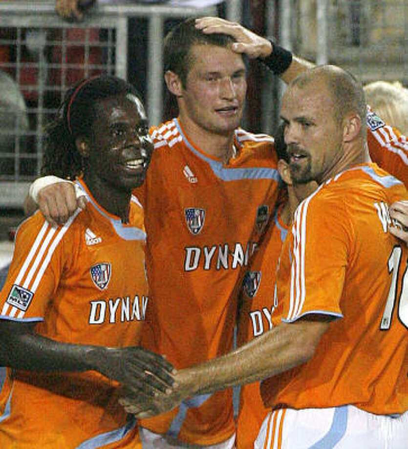 Nate Jaqua (second from left) had the only goal in Tuesday's 1-0 win for the Dynamo over Club America. Photo: Steve Campbell, Chronicle