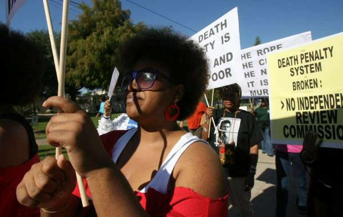 Ariel Brinkley was among roughly 200 people protesting the death penalty during the march Saturday in Houston's Third Ward.