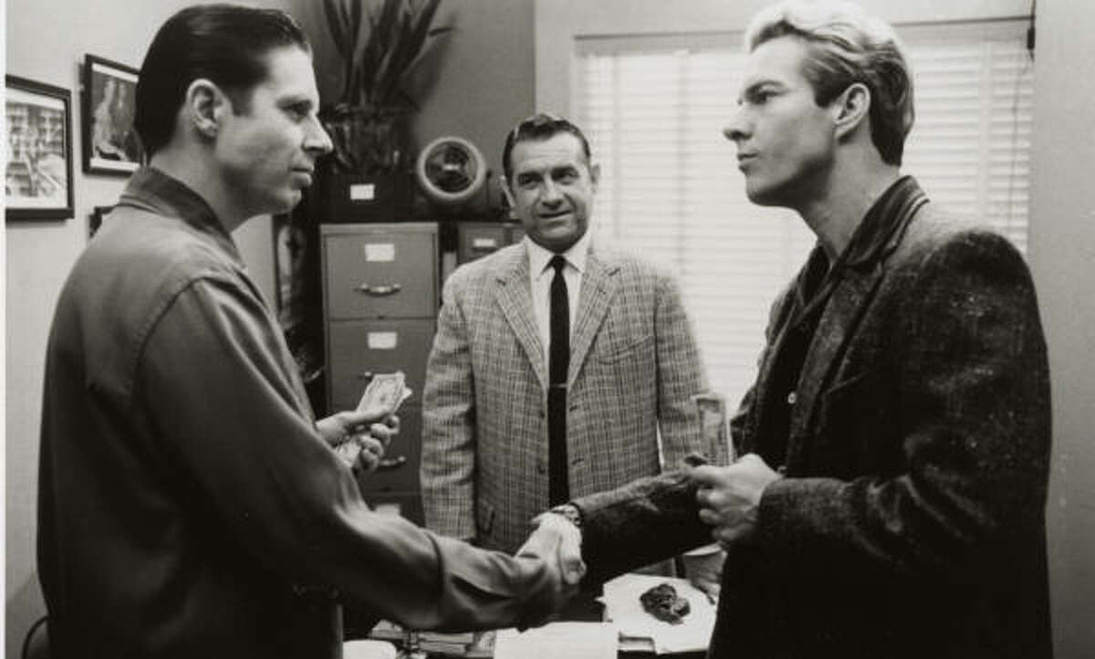 Wilson, center, portrayed legendary record producer Sam Phillips in the Jerry Lee Lewis biopic Great Balls of Fire.