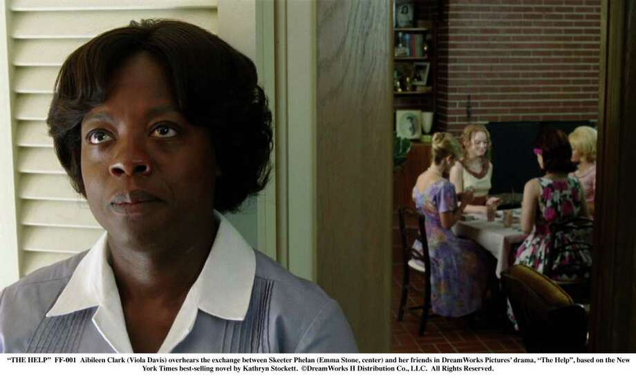 """""""THE HELP""""  FF-001  Aibileen Clark (Viola Davis) overhears the exchange between Skeeter Phelan (Emma Stone, center) and her friends in DreamWorks Pictures' drama, """"The Help"""", based on the New York Times best-selling novel by Kathryn Stockett.  ©DreamWorks II Distribution Co., LLC. All Rights Reserved. / ©DreamWorks II Distribution Co., LLC. All Rights Reserved."""