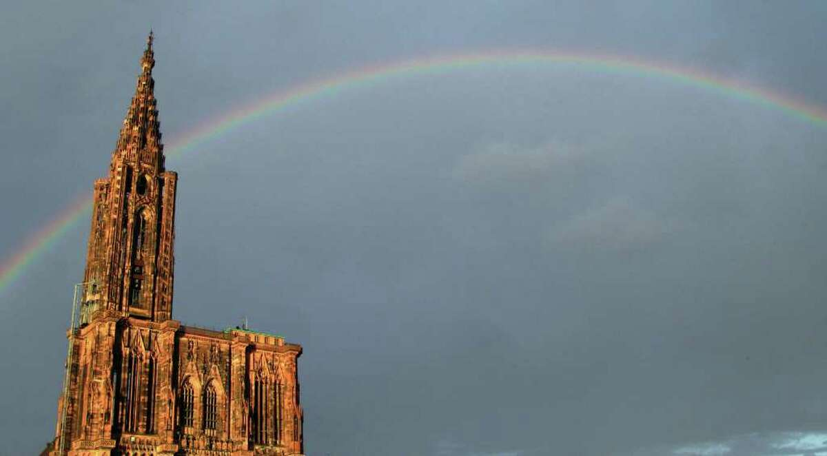 A rainbow appears after a rain shower over the Strasbourg cathedral, eastern France, on August 08, 2011.
