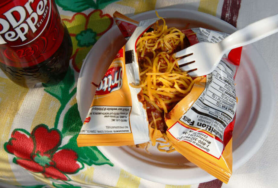 Enjoy Frito Pie - corn chips and chili - straight from the bag. Photo: Johnny Hanson, For The Chronicle