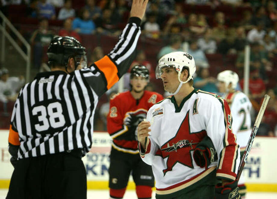 Erik Reitz consults with referee Francois St. Laurent. The Aeros were hit with 38 minutes in penalties, compared with 12 for Omaha. Photo: Bob Levey, For The Chronicle