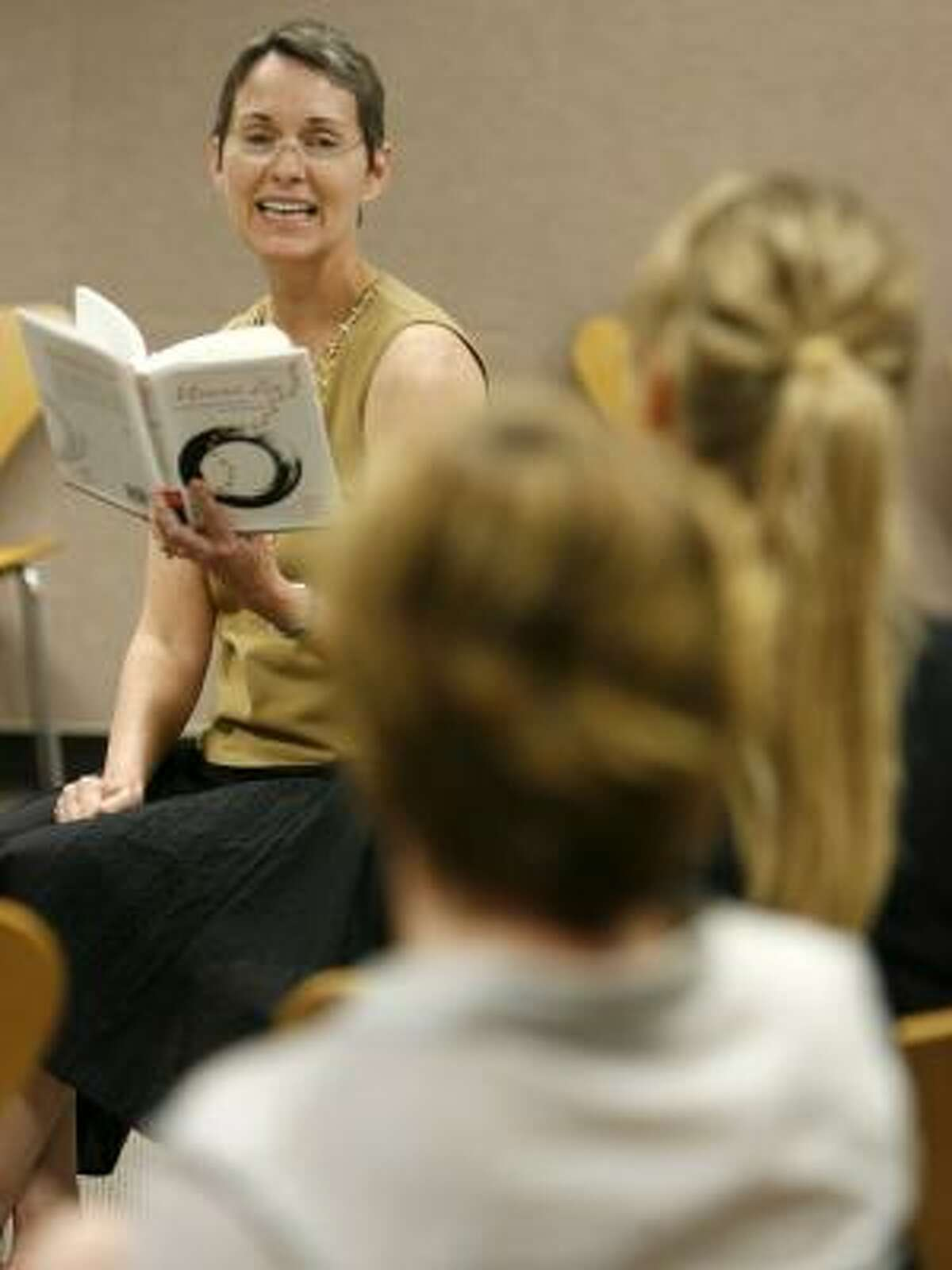Karen Miller reads from her book during an appearance at the Heights Library.