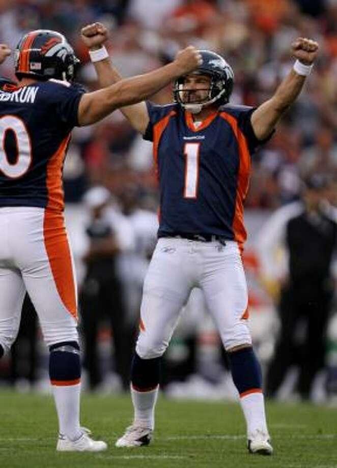Kicker Jason Elam (1) of the Denver Broncos celebrates his game winning 23-yard field goal. Photo: Doug Pensinger, Getty Images