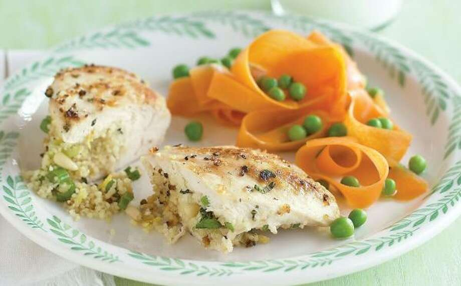 A GOOD FILLING:Kick up the flavor of chicken breasts with a lively stuffing of herbed couscous. Photo: JOHN KERNICK, EVERYDAY FOOD