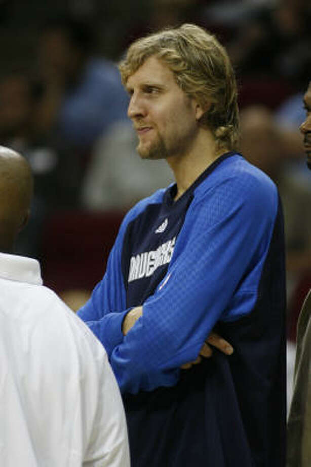 Dirk Nowitzki remained on the bench for the entire game during the Rockets 104-90 win over the Dallas Mavericks. Photo: Kevin Fujii, Chronicle