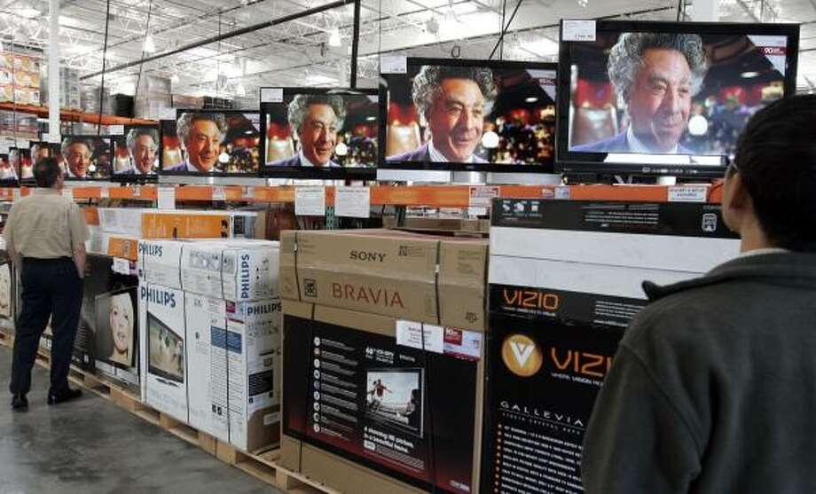 Dustin Hoffman hawks an upcoming movie on multiple TV screens at a San Jose, Calif., Costco. The Consumer Electronics Association is expecting $48.1 billion in sales in the fourth quarter. Photo: PAUL SAKUMA, ASSOCIATED PRESS