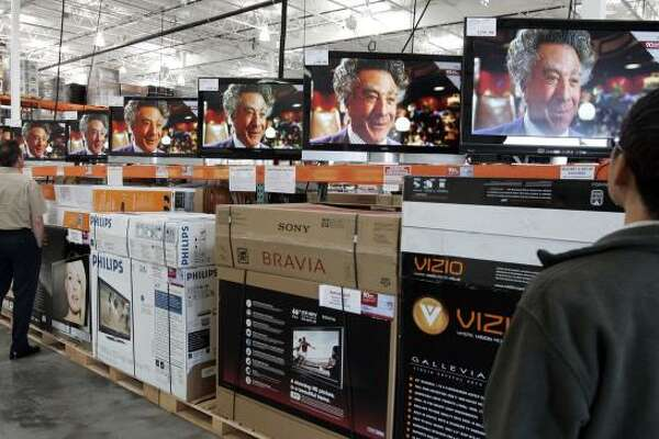 Dustin Hoffman hawks an upcoming movie on multiple TV screens at a San Jose, Calif., Costco. The Consumer Electronics Association is expecting $48.1 billion in sales in the fourth quarter.