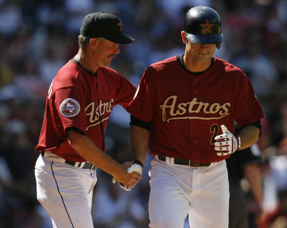 Chris Burke (right) has waited patiently for his time to shine with the Astros. Photo: KAREN WARREN, Chronicle