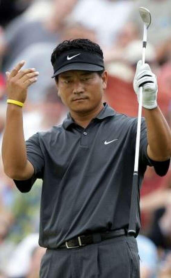 K.J. Choi tries to coax a chip shot closer to the hole. Photo: JAY LaPRETE, AP