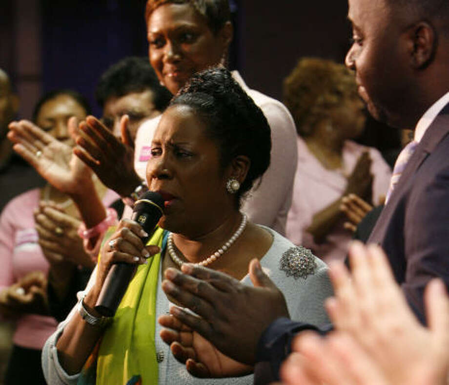 Rep. Sheila Jackson Lee, D-Texas, is applauded as she is introduced during Sunday services at the CRM City Fellowship Church main campus. Afterward, she celebrated the impending increase in the minimum wage from $5.15 to $5.85 an hour. The hike takes effect on Tuesday. Photo: James Nielsen, Chronicle