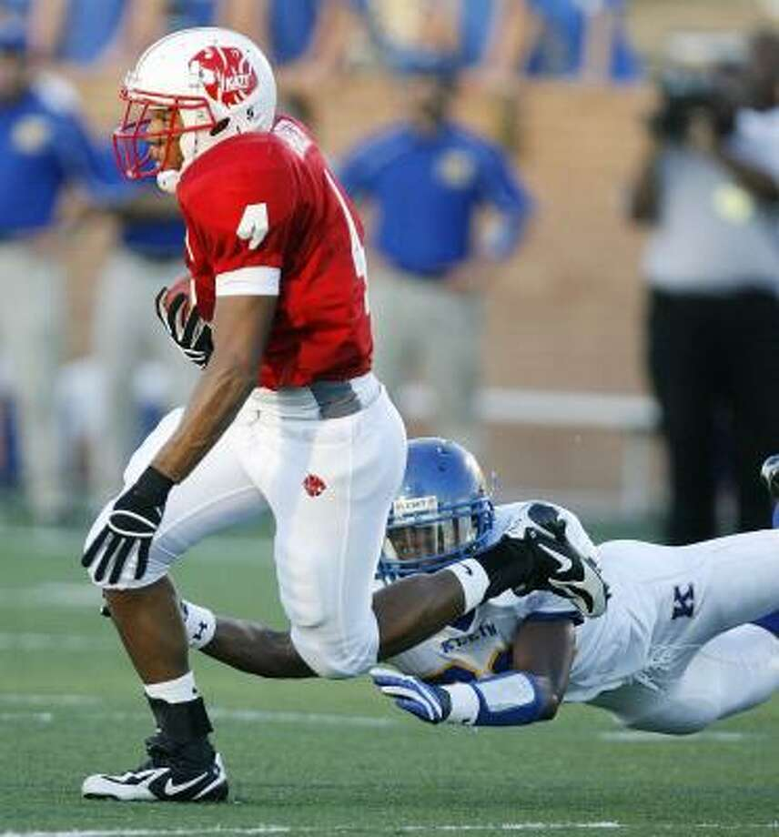 Trent Hunter (4) provides a fast start to Katy's 45-0 win as he runs back the opening kickoff 100 yards for a score. Photo: BILLY SMITH II, CHRONICLE