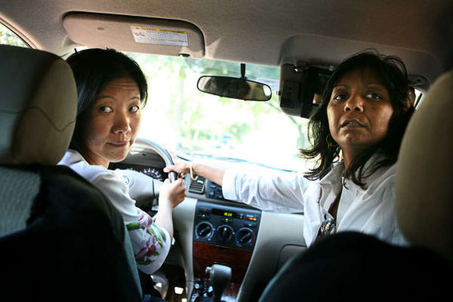 Preety Maring, 27, left, is learning to drive with instruction from Deena Patel, who has been a driving instructor for 15 years in Houston.  Patel, who runs her own driving instruction service, Vinod Driving School Corp., gears her lessons toward immigrant students. Photo: ERIN TRIEB, For The Chronicle