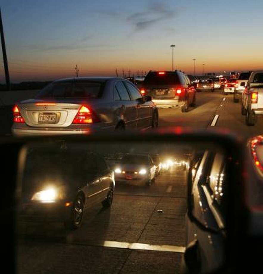 This is what drivers on U.S. 59 South contend with every evening as they approach the Brazos River. Traffic once carried by twin spans of three lanes each has been diverted onto smaller spans of two lanes. Photo: KEVIN FUJII, CHRONICLE
