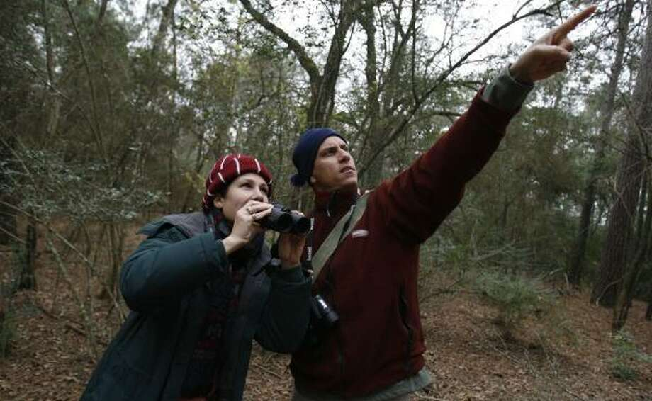 Della Barbato, left, and Jaime Gonzalez help with the annual Christmas Bird Count Saturday at the Houston Arboretum & Nature Center. It's part of an international effort that's taken place for 108 years. Photo: KAREN WARREN PHOTOS, CHRONICLE
