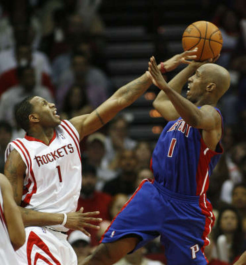 Tracy McGrady and Co. made life miserable for Chauncey Billups, right, and the visiting Detroit Pistons Thursday night at Toyota Center. Photo: Kevin Fujii, Chronicle