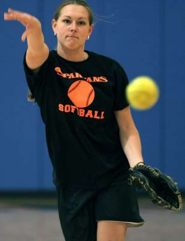 Northampton's Kristy Kroll, who spent a year in Iraq with a medical unit, works on her pitching during Friday's practice. Photo: STEVE KLAVER, ASSOCIATED PRESS