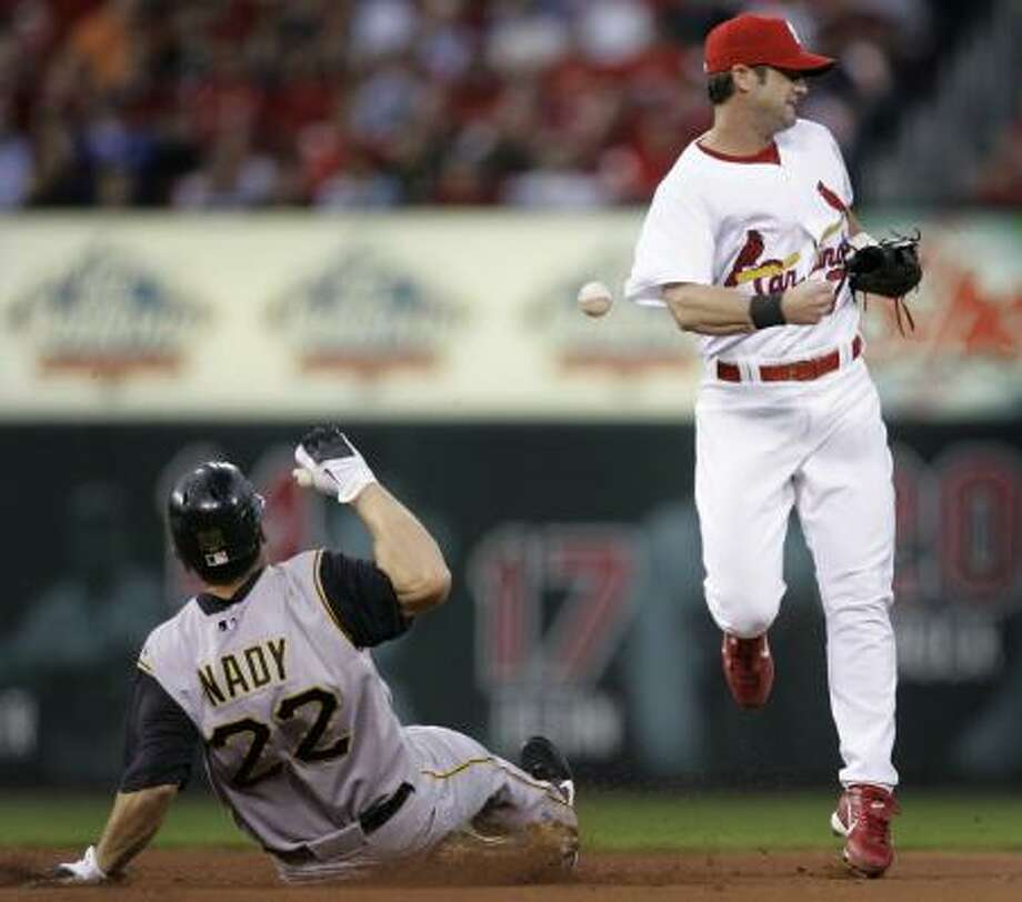 The Cardinals' Adam Kennedy, right, gets the forceout on Xavier Nady but loses a shot at a double play with a bobble. Photo: JEFF ROBERSON, ASSOCIATED PRESS