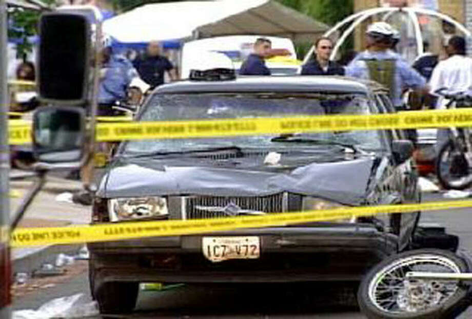 This image taken from video provided by Fox 5 News WTTG shows a car that plowed into a street festival in Washington on Saturday. Photo: AP