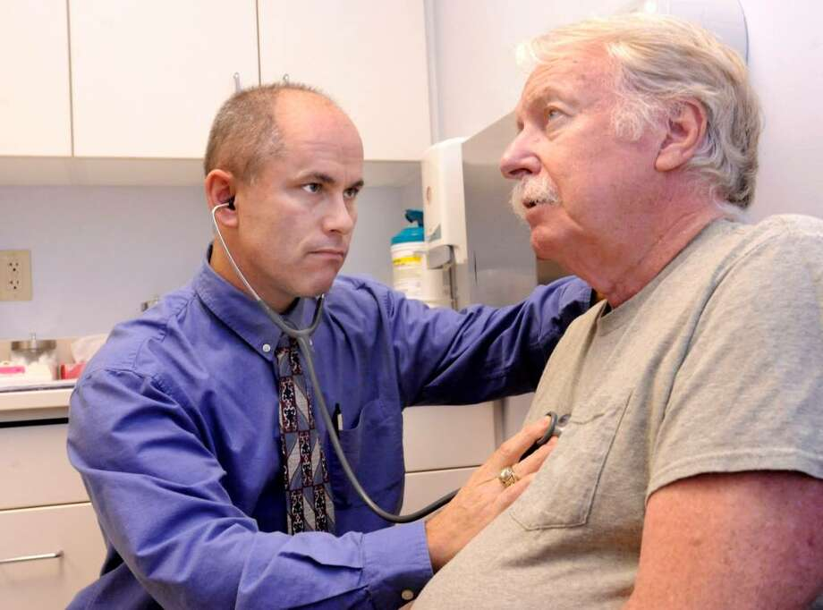 Dr.Casey Ott examining Garry Burdick, 76, of Southbury, at the Southbury Geriatric Center on Friday, Sept. 25,2009. Photo: Michael Duffy / The News-Times
