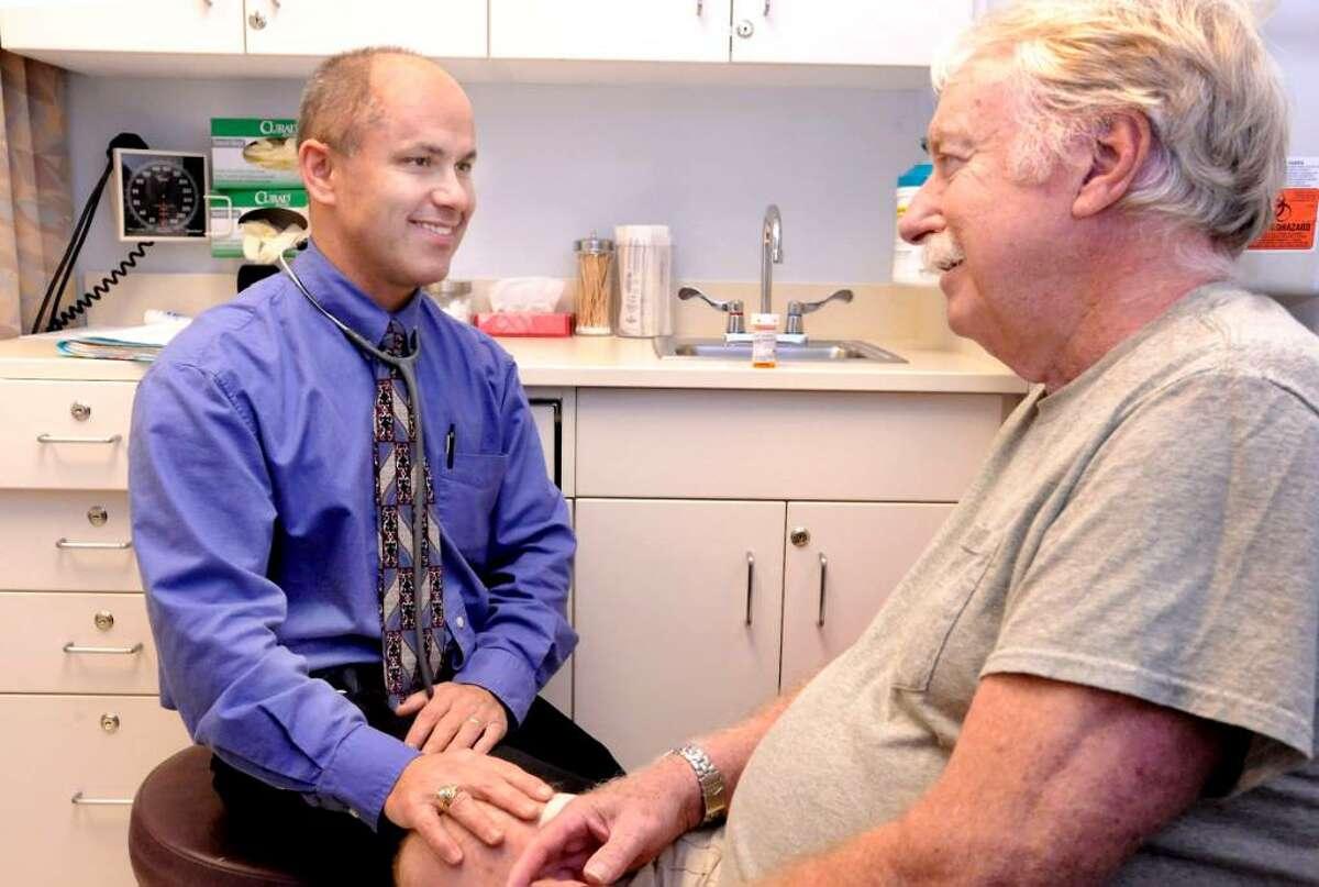 Dr.Casey Ott examining Garry Burdick, 76, of Southbury, at the Southbury Geriatric Center on Friday, Sept. 25,2009.