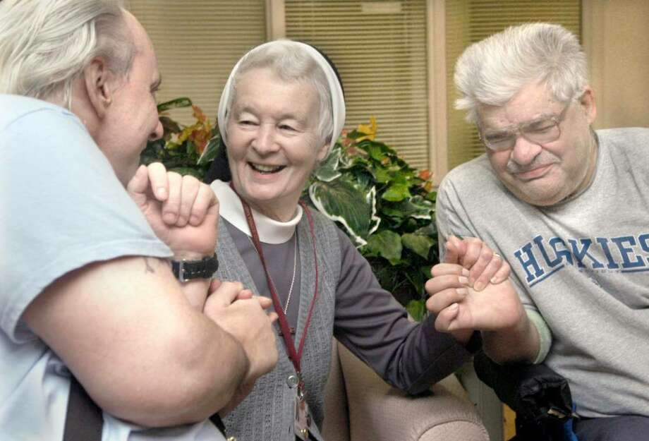 Sister Frances Smalkowski, center, Director of Pastoral Care at Pope John Paul ll Care and Rehabilitation Center with residents Mark Richard,44, left and Stanley Faust, 52, Friday Oct. 9, 2009 Photo: Carol Kaliff / The News-Times