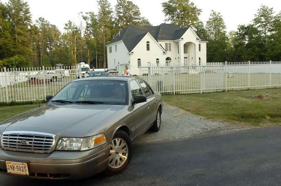 Authorities finish working for the day at a home owned by Falcons quarterback Michael Vick near Surry, Va. Federal law enforcement officials descended on the home Thursday armed with a search warrant that suggests they're taking over an investigation into Vick's possible involvement in dogfighting. Photo: Gary C. Knapp, AP