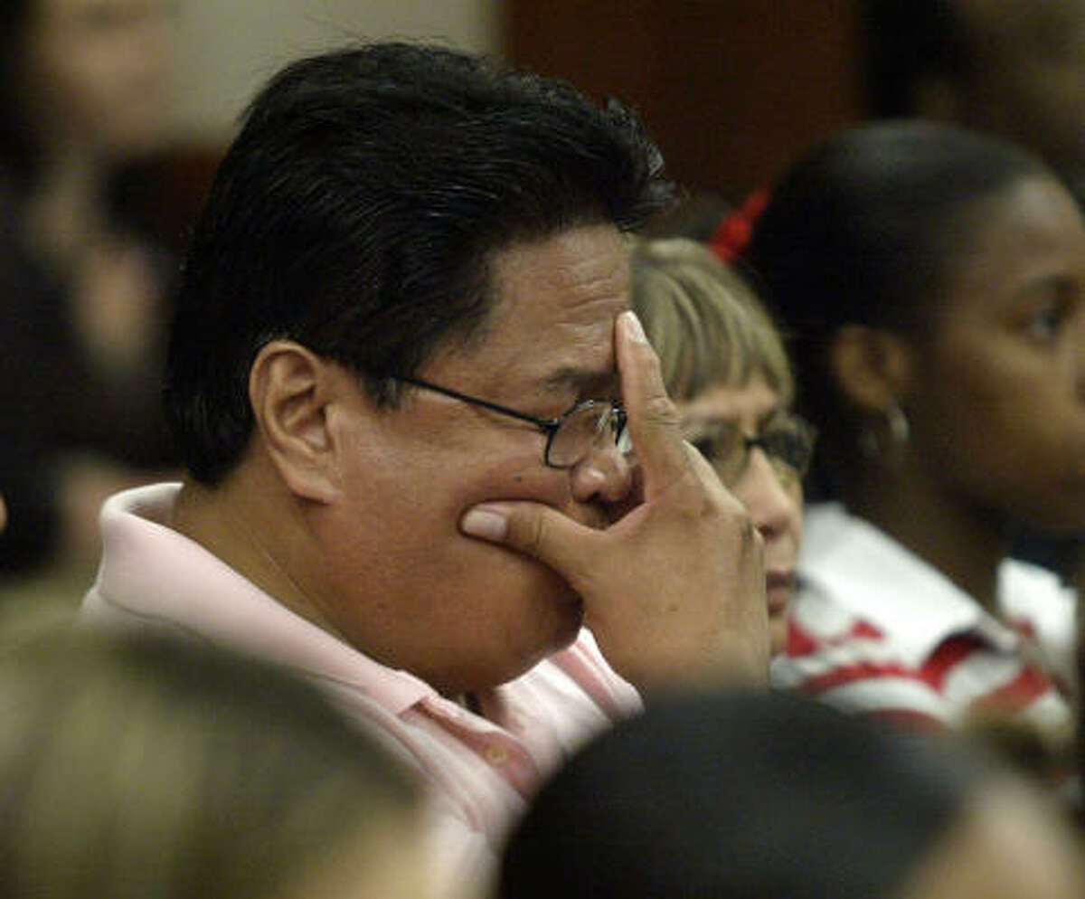 Protasio Aparece Jr., murder victim Maria Aparece's father, listens on Wednesday as the charges are read against Dexter Johnson, who was convicted of killing the woman in an attack that also claimed the life of her boyfriend, Huy Ngo.