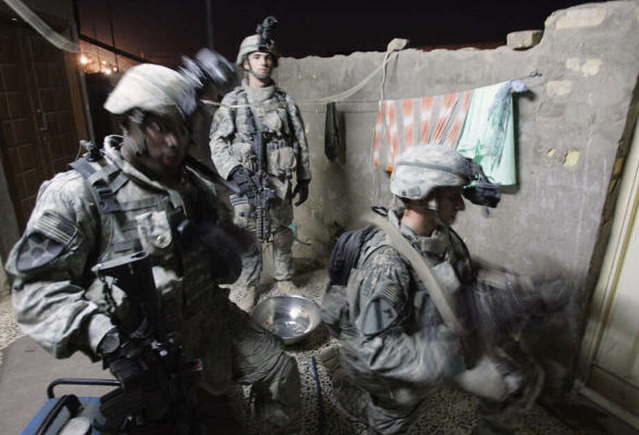 U.S. soldiers search an Iraqi house Tuesday during an operation in the suburbs of Baqouba, northeast of Baghdad. Photo: ALEXANDER NEMENOV, AFP/GETTY IMAGES
