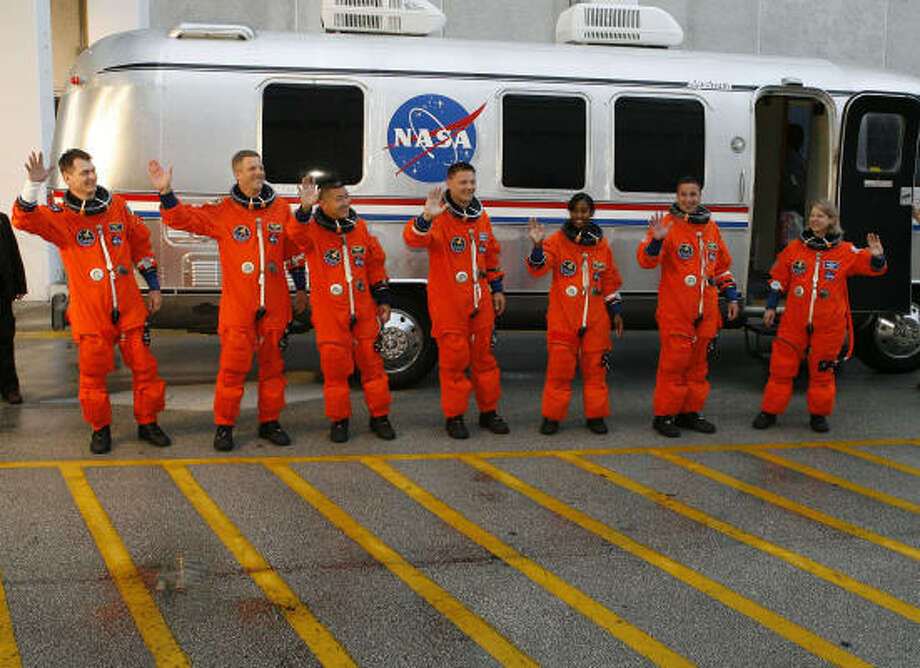 Discovery crew members, from left, Paolo Nespoli, Scott Parazynski, Daniel Tani, Doug Wheelcok, Stephanie Wilson, George Zamka and mission Commander Pam Melroy are seen during the crew walkout Tuesday. Photo: James Nielsen, Chronicle