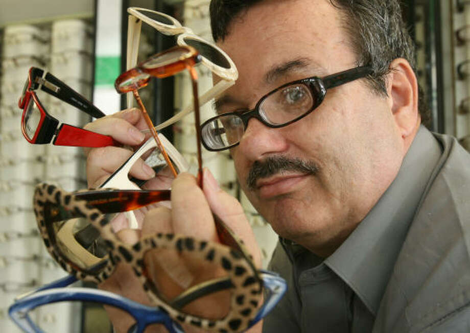 Philip Brown of Smith's Opticians has developed a loyal following thanks to the eclectic mix of frames he offers. Photo: Billy Smith II, Chronicle