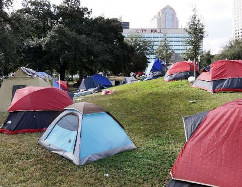 Tents of homeless people fill Duncan Plaza across from City Hall in New Orleans last week. Some are reluctant to leave, believing the housing offered would not be an improvement. Photo: ANN HEISENFELT, ASSOCIATED PRESS