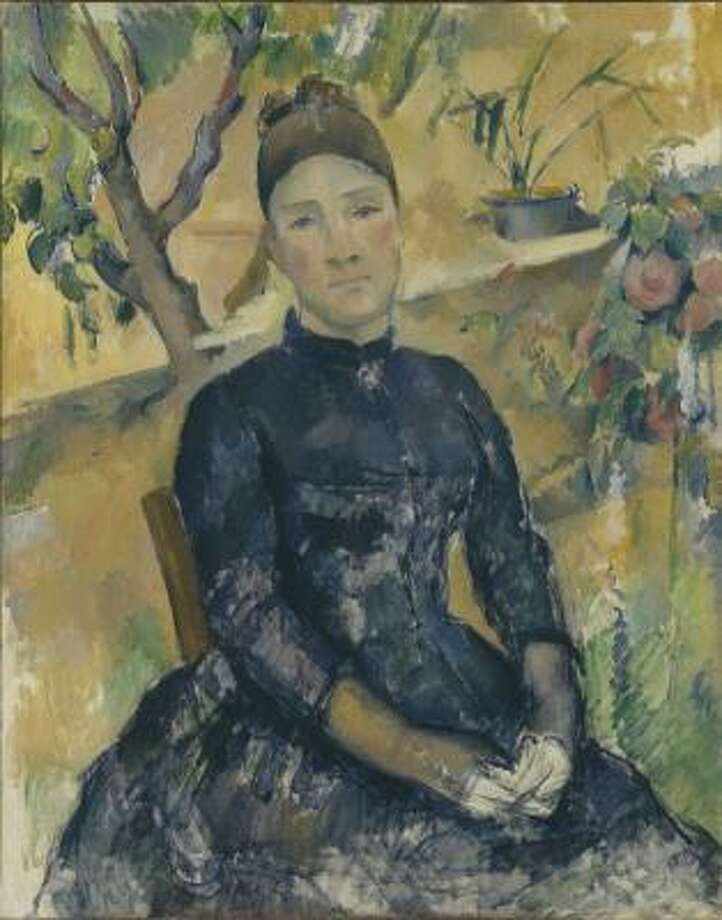 Paul Cézanne's painting Madame Cézanne (Hortense Fiquet, 1850-1922) in the Conservatory is one of the works to be on display at the Museum of Fine Arts, Houston. Photo: Metropolitan Museum Of Art